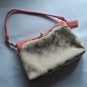 Coach EUC fabric with pink leather trim wristlet